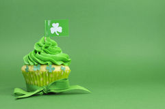 Happy St Patricks Day green cupcake with shamrock flag Royalty Free Stock Photo