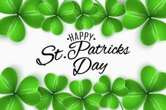 Happy St. Patricks Day. Greeting invitation card. Clovers of shamrocks on white background. Calligraphic decorative text. Festive. Template for your design Stock Photo