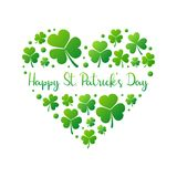 Happy St. Patricks Day vector heart on white background. Happy St. Patricks Day heart made of bright green small shamrocks or clovers on white background. Vector Royalty Free Stock Images