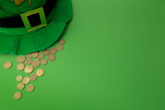 Happy St Patricks Day leprechaun hat with gold coins on green background. Top view. Happy St Patricks Day leprechaun hat with gold coins on green background Royalty Free Stock Photos