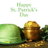 Happy St Patricks Day. Saint Patricks day hat and pot of gold for the festive Irish celebrations Royalty Free Stock Photos
