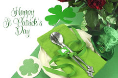Happy St Patricks Day table setting with shamrocks and leprechaun hat and sample text Stock Image