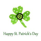 Happy St Patricks Day text with shamrock. Happy St Patrick Day text with handmade paper shamrock on a white background Stock Photos
