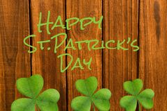 Happy st patricks day. On wooden background Royalty Free Stock Photos