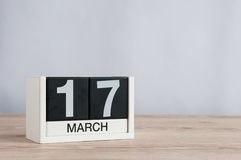 Happy St Patricks Days save the date. March 17th. Day 17 of month, wooden calendar on light background. Spring time Stock Photography