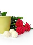 Happy St. Valentine's day. Red roses and cup of tea isolated on white backgroung Stock Photo