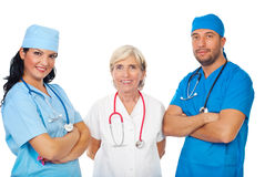 Happy staff of doctors Stock Images