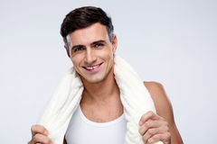 Happy standing man with towel. Over gray background Stock Photography