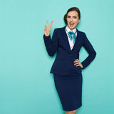 Happy Stewardess Is Showing Victory Hand Sign Stock Photo