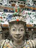 Happy stone woman. Woman stone statue with ceramics in Grand Palace (Bangkok - Thailand royalty free stock photo