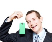 Happy store sales man with blank price tag Royalty Free Stock Photography
