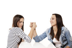 Happy and strained teenager arm wrestling Royalty Free Stock Images