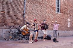 Happy street musicians at Toulouse city. A group of four joly street musicians and comediants perform in the old quarter of the french city of Toulouse, capital stock images