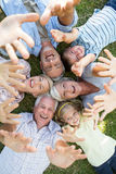 Happy stretched out family raising up their hands. On a sunny day Royalty Free Stock Photography