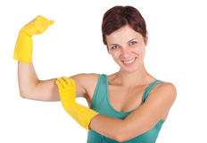 Happy strong cleaning woman. Smiling woman wearing cleaning gloves showing muscular strength Stock Image