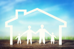Happy strong family in home. Concept made of paper characters stock photos