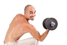 Happy strong man lifting weights. Royalty Free Stock Photos