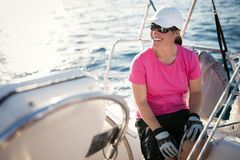 Happy strong woman sailing with her boat Royalty Free Stock Photos