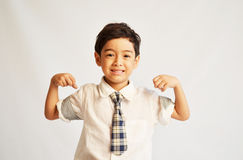 Happy and strong student in uniform Royalty Free Stock Photos