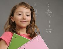 Happy Student. Young elementary age student proud of her accomplishments Royalty Free Stock Photography