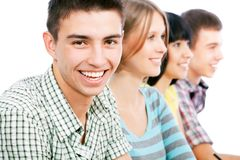 Happy student. Portrait of a happy student and his friends Royalty Free Stock Photography
