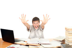 Happy Student. On the School Desk shows his palms. Isolated on the White Background Royalty Free Stock Photos