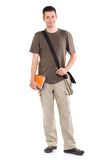 Happy student. Young man standing with book and bag, isolated on white Royalty Free Stock Images