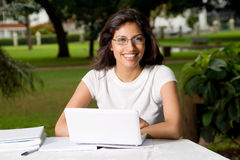 Happy student. Young happy beautiful female college student studying outdoors in campus Stock Images