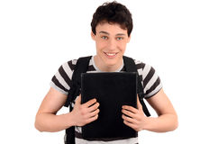 Happy student back to school. Handsome student smiling holding a notebook. Stock Images