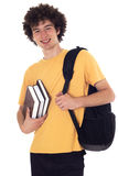 Happy student with backpack and books. Smiling happy student standing with backpack and books. Isolated on white Stock Photo