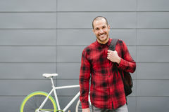 Happy student with backpack looking camera. Royalty Free Stock Photos