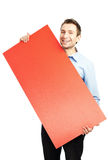 Happy student with blank red billboard. Happy student standing with red blank billboard. Isolated on white Stock Image
