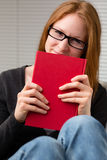 Happy Student with a Book at Home Stock Photography