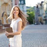 Happy student with book Stock Image