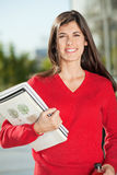 Happy Student With Books Standing On Campus Royalty Free Stock Photography