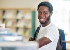 Happy Student In Bookstore Stock Images