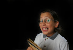 Happy student boy. With glasses and a book royalty free stock photography