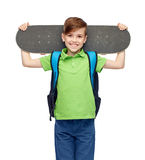 Happy student boy with backpack and skateboard Royalty Free Stock Photos