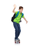 Happy student boy with backpack and skateboard Stock Photography