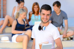 Happy student boy with books outside college Royalty Free Stock Photography