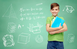 Happy student boy with folders and notebooks Stock Photo