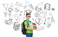 Happy student boy with school bag and books. Childhood, school, education, learning and people concept - happy smiling student boy in eyeglasses with school bag Stock Image
