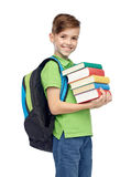 Happy student boy with school bag and books. Childhood, school, education and people concept - happy smiling student boy with school bag and books Royalty Free Stock Image
