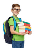 Happy student boy with school bag and books Stock Photo