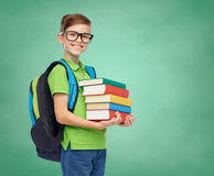 Happy student boy with school bag and books Stock Photos