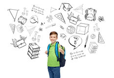 Happy student boy with school bag. Childhood, school, education, learning and people concept - happy smiling student boy with school bag with doodles Stock Photos