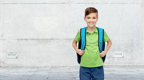 Happy student boy with school bag. Childhood, school, education and people concept - happy smiling student boy with school bag over urban street background Stock Photos