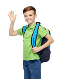 Happy student boy with school bag waving hand Royalty Free Stock Photo