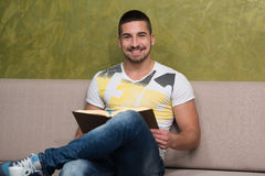 Happy Student At Cafe Reading A Book Royalty Free Stock Photo