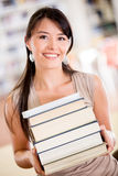 Happy student carrying books Royalty Free Stock Photography